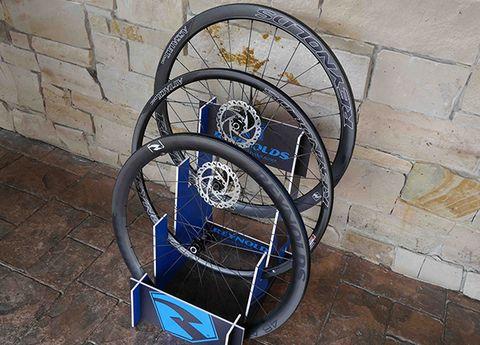 Spoke, Iron, Mechanical fan, Electric fan, Brick, Brickwork, Circle, Bicycle wheel rim, Cobblestone, Steel,