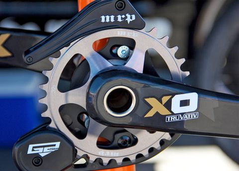 Bicycle part, Bicycle drivetrain part, Crankset, Bicycle accessory, Gear, Steel, Groupset, Bicycle, Circle, Carbon,