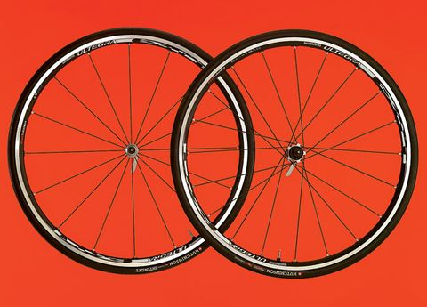 Wheel, Bicycle wheel rim, Spoke, Rim, Red, Orange, Bicycle tire, Line, Bicycle wheel, Synthetic rubber,