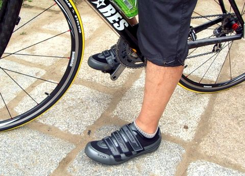 Footwear, Bicycle tire, Tire, Wheel, Bicycle wheel rim, Leg, Shoe, Bicycle wheel, Bicycle part, Human leg,