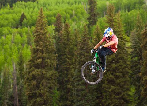 Tire, Wheel, Bicycle wheel, Bicycle frame, Mountain bike, Bicycle, Bicycle part, Mountain biking, Helmet, Recreation,