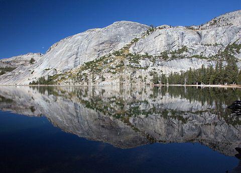 Mountainous landforms, Mountain range, Water resources, Reflection, Natural landscape, Mountain, Bank, Terrain, Hill, Tarn,