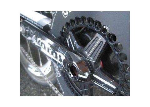 Automotive tire, Rim, Bicycle drivetrain part, Font, Automotive wheel system, Auto part, Synthetic rubber, Metal, Gear, Steel,
