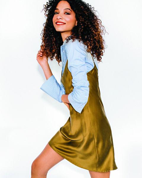 Slip dress over button-down shirt