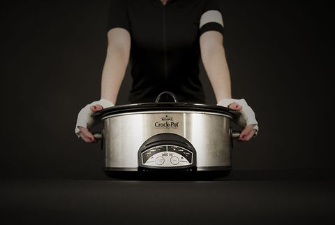 cyclist holding slow cooker