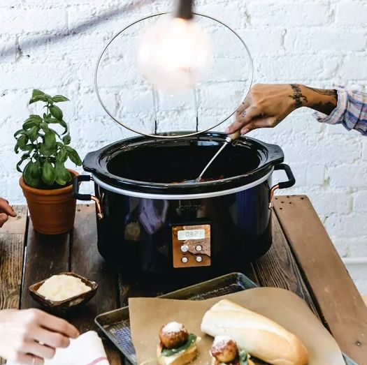 women using a crux slow cooker to make meatballs