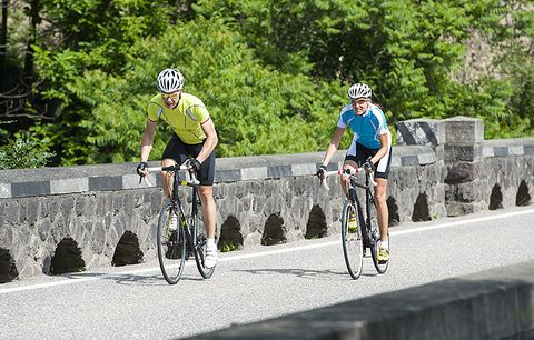 road cyclists on a bridge