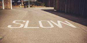 Slow Written On Road