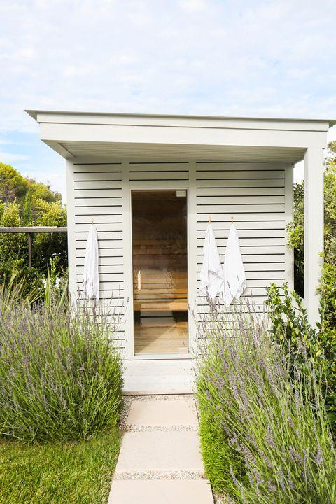 free standing sauna in garden