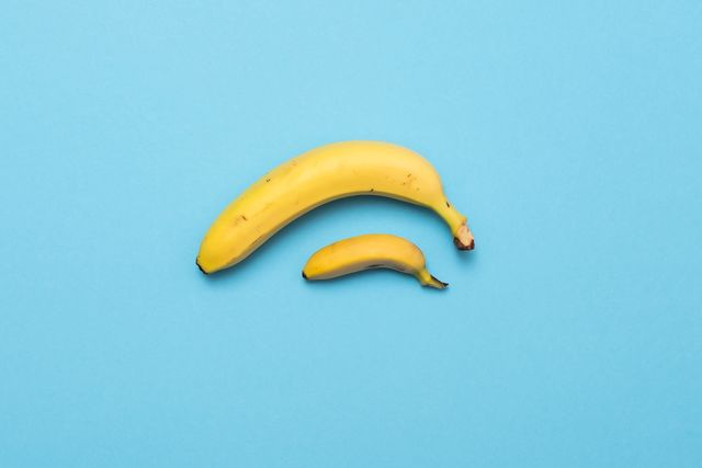 small banana compare size with banana on blue background size penis concept