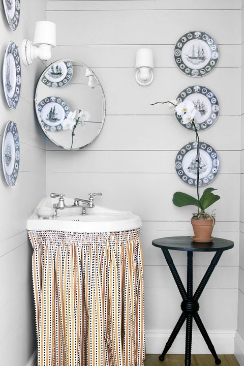small powder room with skirted vanity