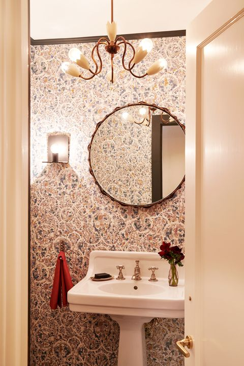 small contemporary powder room with antique pendant