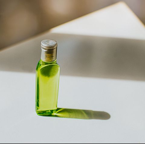 small bottle containing green liquid soap   space for copy