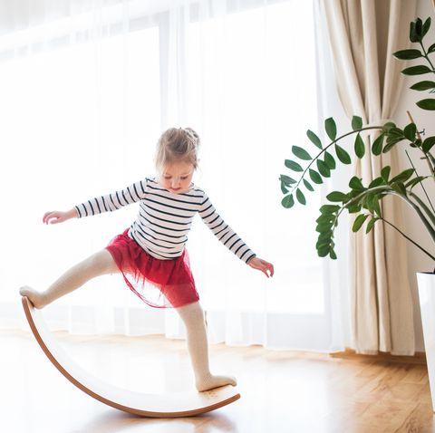 a small girl at home, having fun