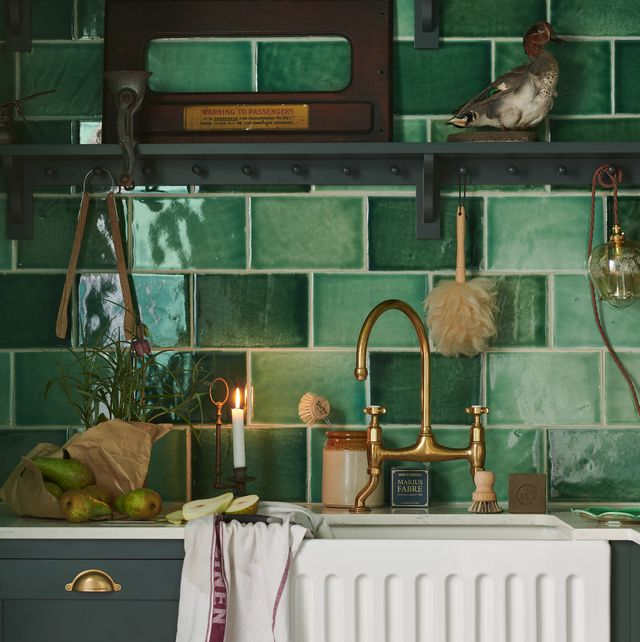 small green kitchen in old cottage is delightfully charming