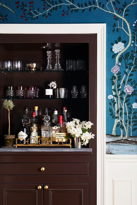 living room with blue wallpaper and bar nook