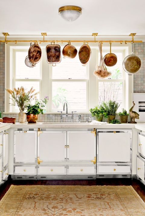 small white kitchen with hanging pots