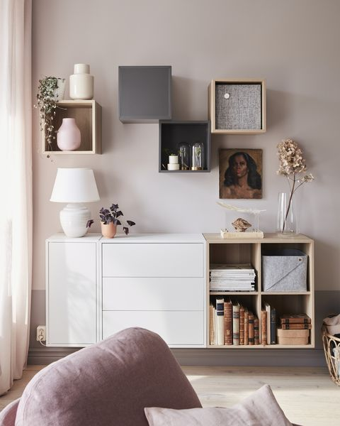 small living room with a cabinet on the wall