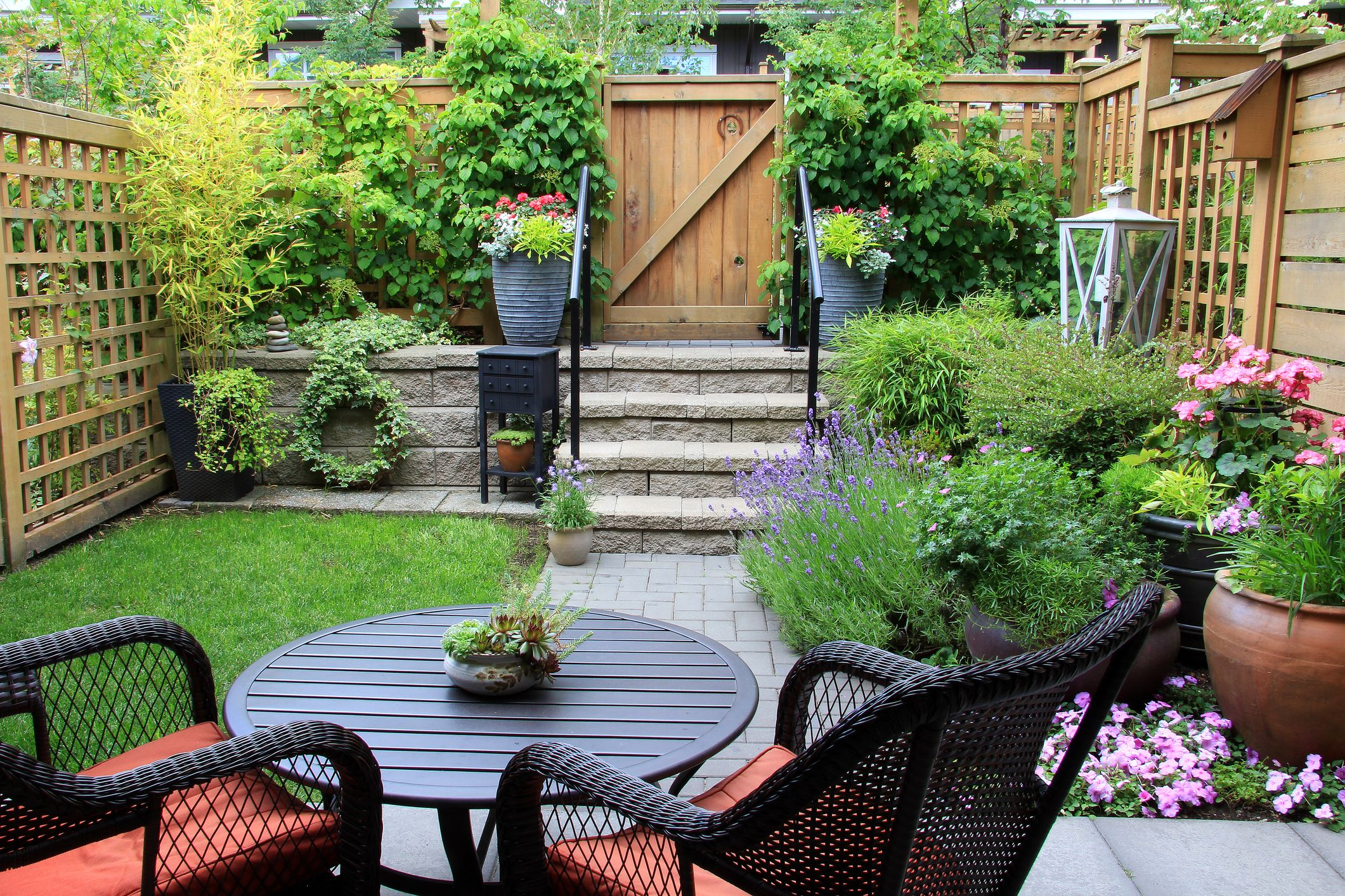 Awesome Small Townhouse Garden With Patio Furniture Amidst Blooming Lavender