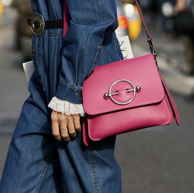 Sleeve, Textile, Denim, Bag, Outerwear, Jacket, Street fashion, Carmine, Fashion, Shoulder bag,