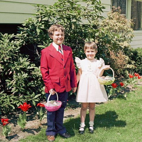 portrait of brother and sister holding easter baskets