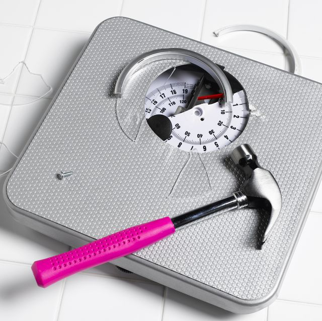 smashed bathroom scales with hammer