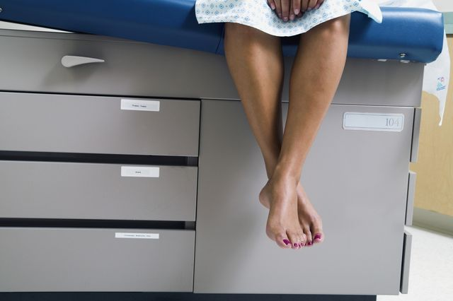 woman waiting for smear test in hospital