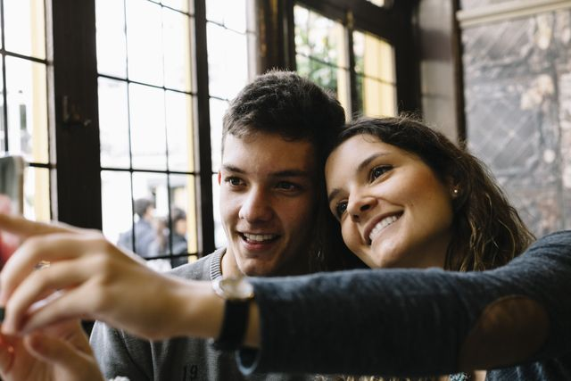 smiling couple taking a selfie