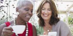women looking at smartphone - explode pension myths