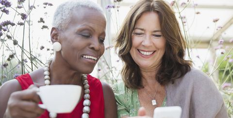 women looking at smartphone - explodepension myths