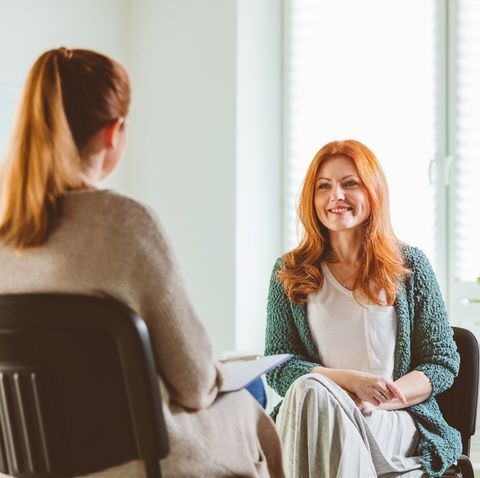 smiling woman with therapist at community center