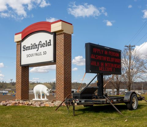 a sign outside the smithfield foods pork processing plant in south dakota, one of the countrys largest known coronavirus clusters, is seen  on april 21, 2020 in sioux falls, south dakota   smithfield foods pork plant in south dakota is closed indefinitely in the wake of its coronavirus outbreak photo by kerem yucel  afp photo by kerem yucelafp via getty images
