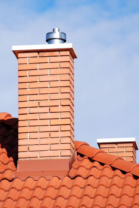 smoke stacks on the tiled roof