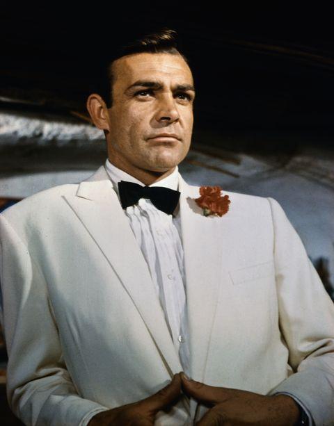 Suit, Formal wear, Tuxedo, Tie, Bow tie, Fashion accessory, White-collar worker, Portrait,