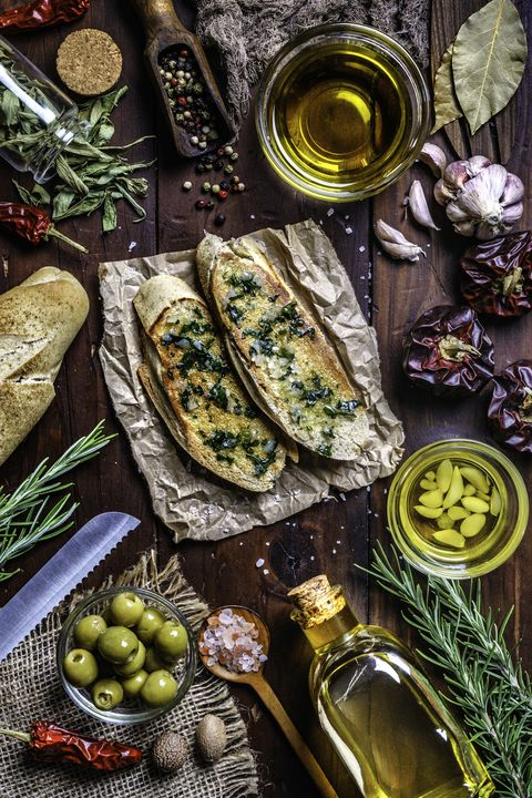 snack or appetizer of garlic basil and olive oil bruschetta on table in a rustic kitchen