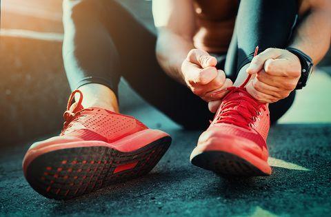 Human leg, Red, Joint, Wrist, Athletic shoe, Carmine, Orange, Muscle, Watch, Running shoe,
