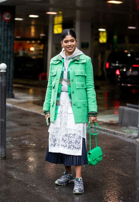 paris, france   march 02 a guest is seen wearing mint green jacket and chanel bag, hoody, white navy skirt outside sacai during paris fashion week   womenswear fallwinter 20202021  day eight on march 02, 2020 in paris, france photo by christian vieriggetty images