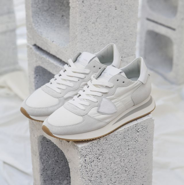 White, Footwear, Shoe, Stone carving, Architecture, Concrete, Athletic shoe, Beige,