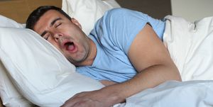 Hilarious looking man snoring loudly