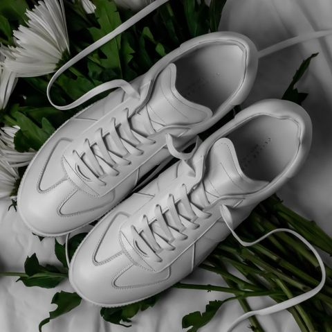 Footwear, White, Shoe, Grass, Sneakers, Athletic shoe, Photography, Still life, Plant, Plimsoll shoe,