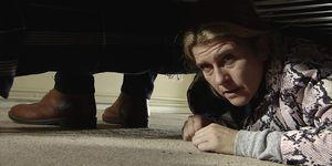 Gina Seddon hides under a bed at Duncan's house in Coronation Street
