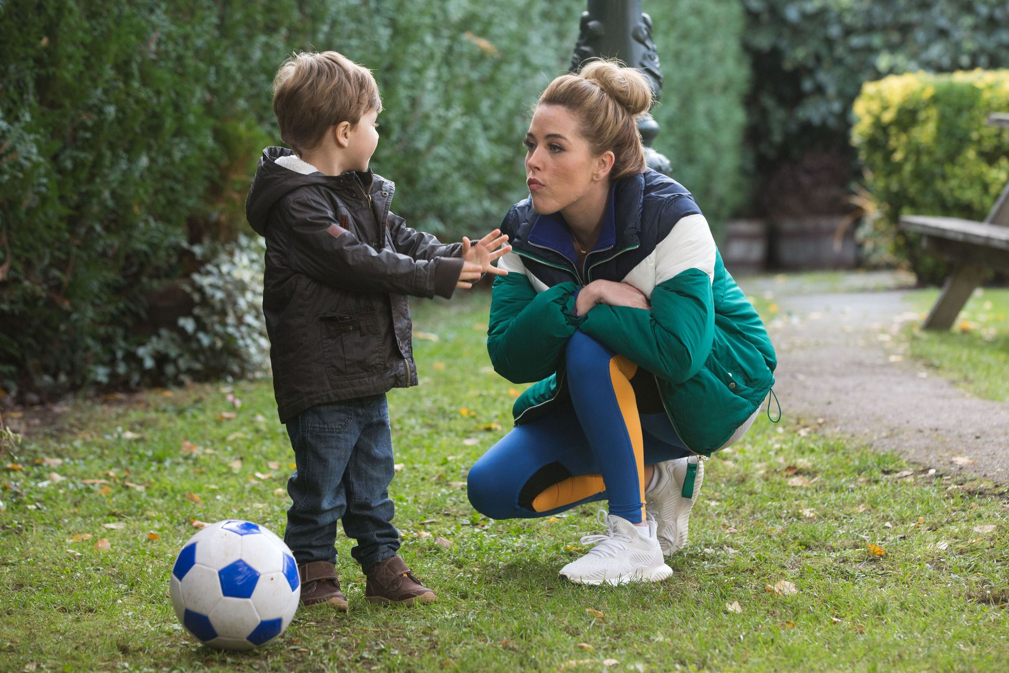 Mick Carter plays football with Megan and Ollie in EastEnders