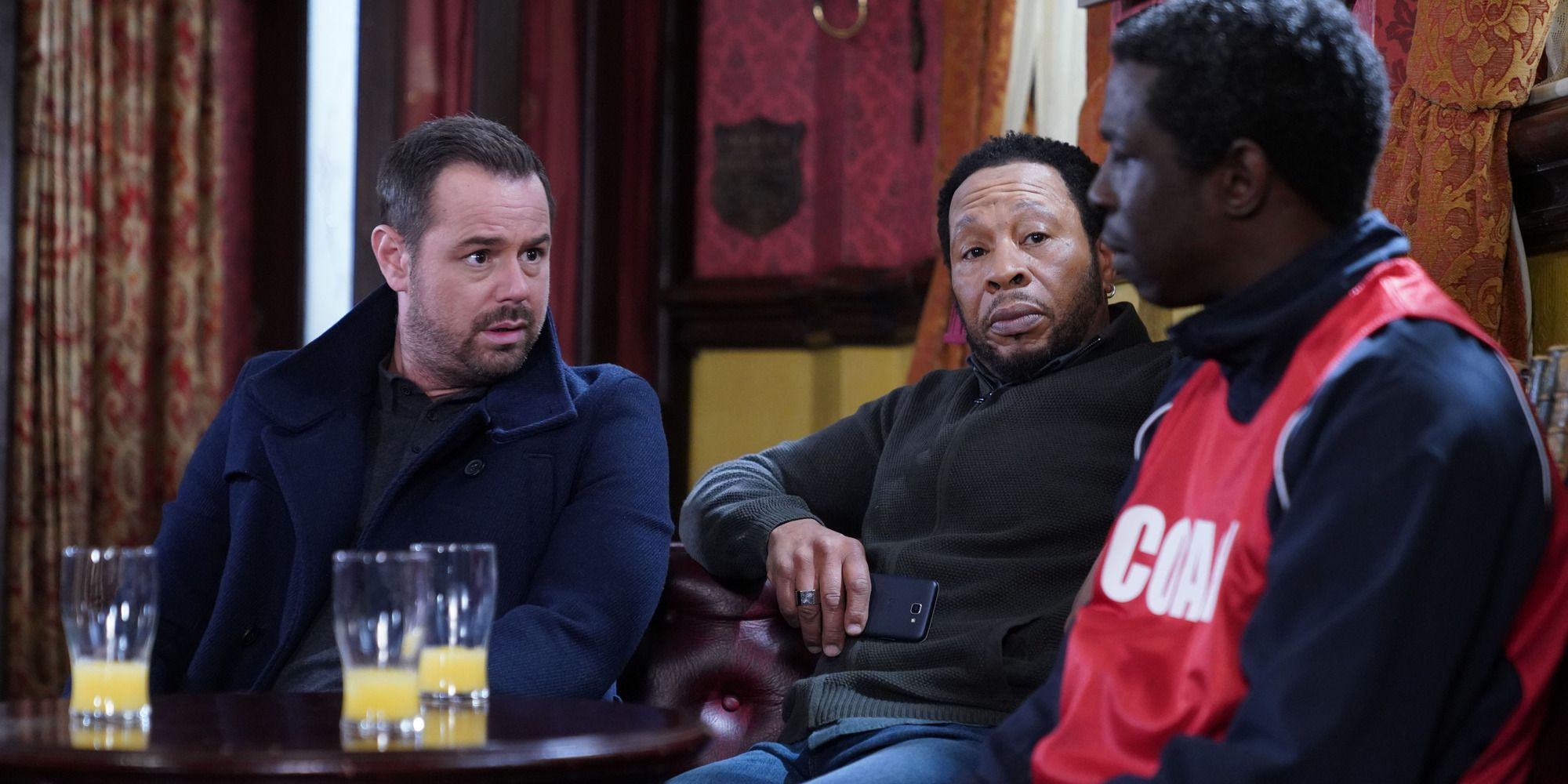 Mick Carter and Mitch Baker speak to Caden at the pub in EastEnders