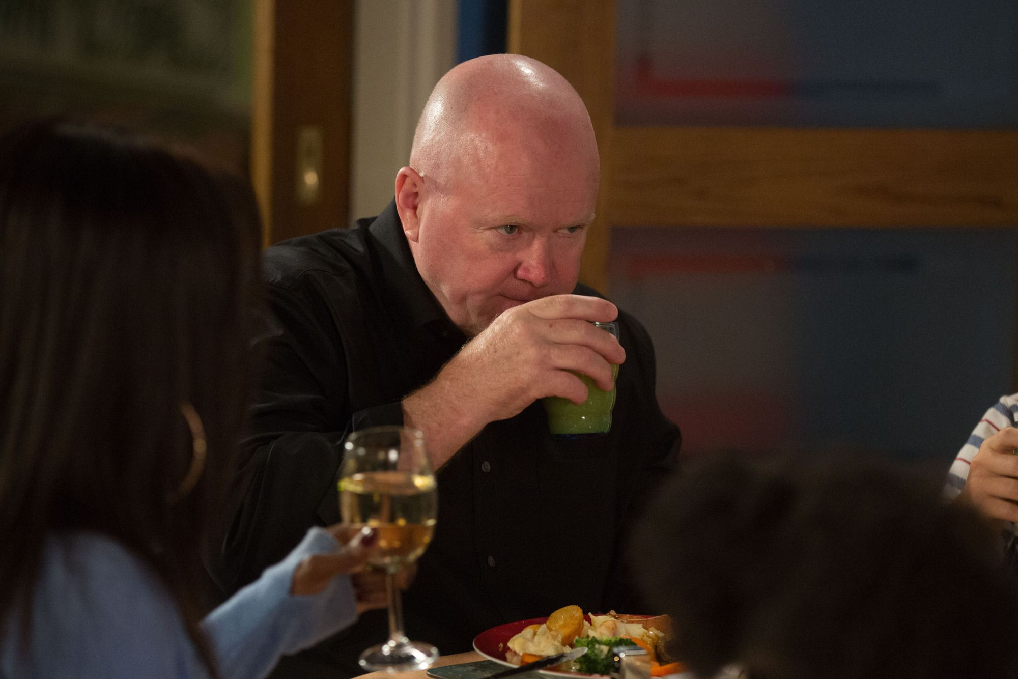 Phil Mitchell is toasted by Kim Fox in EastEnders