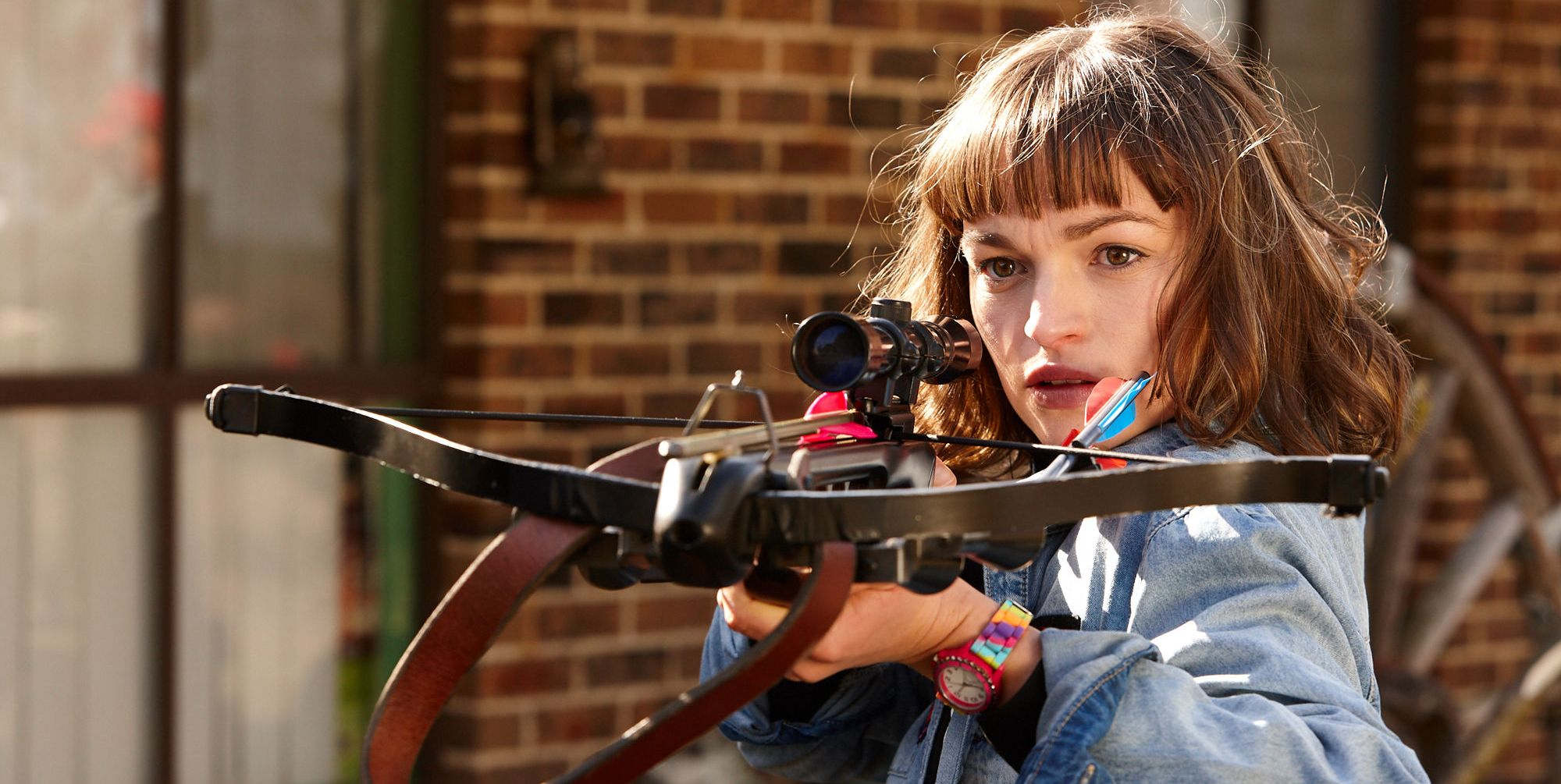 Bella Nixon points a crossbow at Colby Thorne in Home and Away