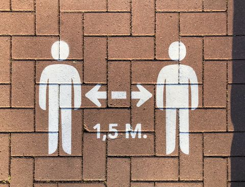 social distancing sign on pavement