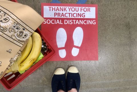social distancing sign on the floor