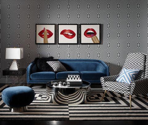 Sofá de terciopelo azul de Jonathan Adler