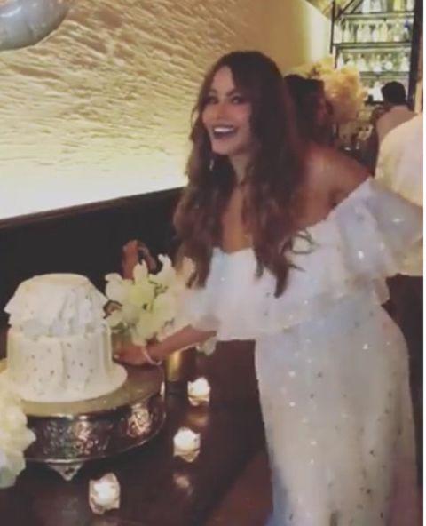 Cake decorating, Cake, Dress, Wedding dress, Wedding cake, Gown, Icing, Bridal clothing, Food, Wedding ceremony supply,