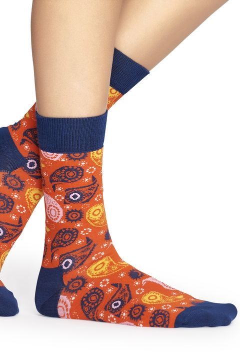 Orange, Footwear, Sock, Visual arts, Joint, Shoe, Design, Fashion accessory, Human leg, Boot,